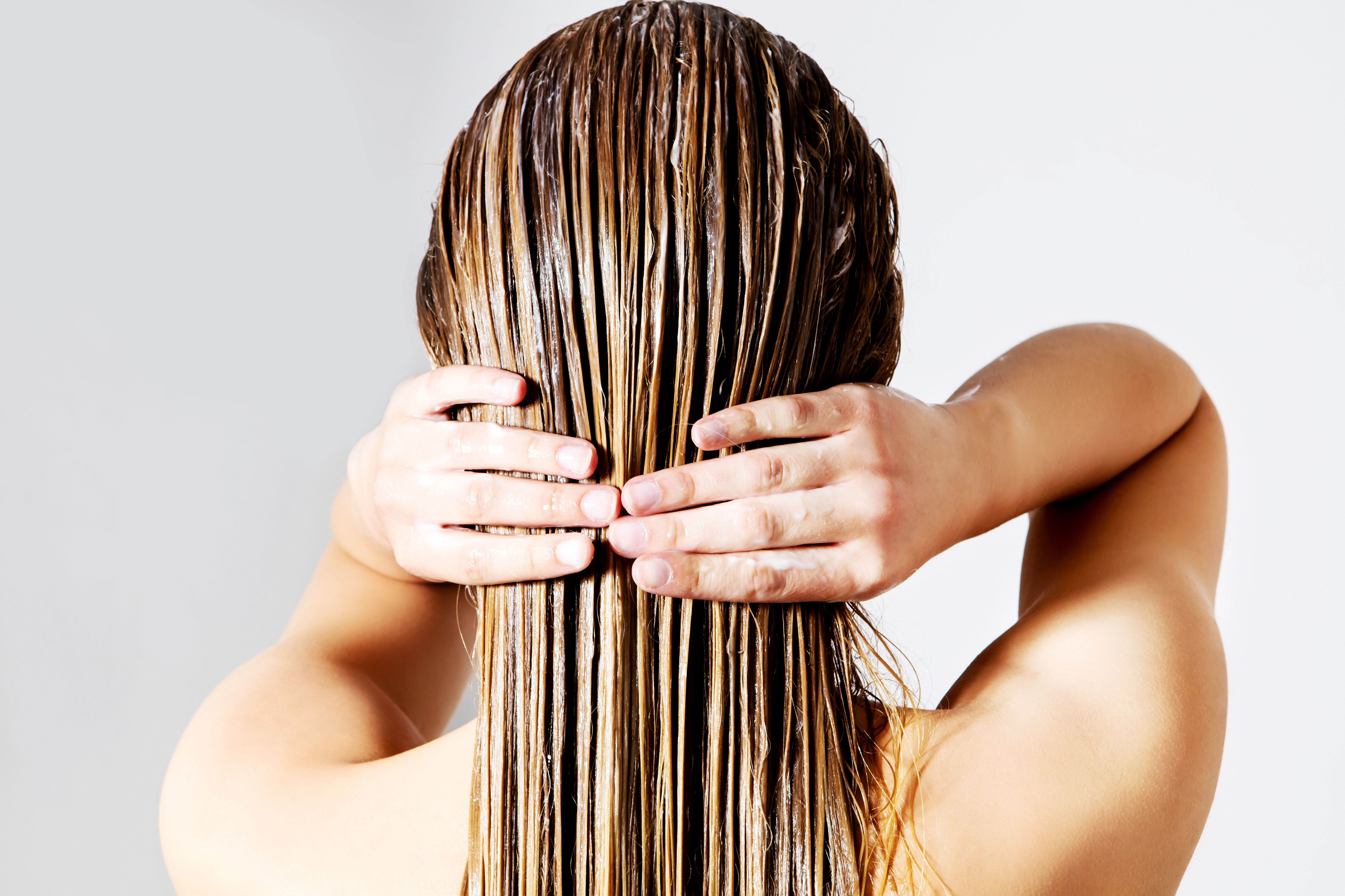 The Best Way To Use Hair Oil, According To Experts