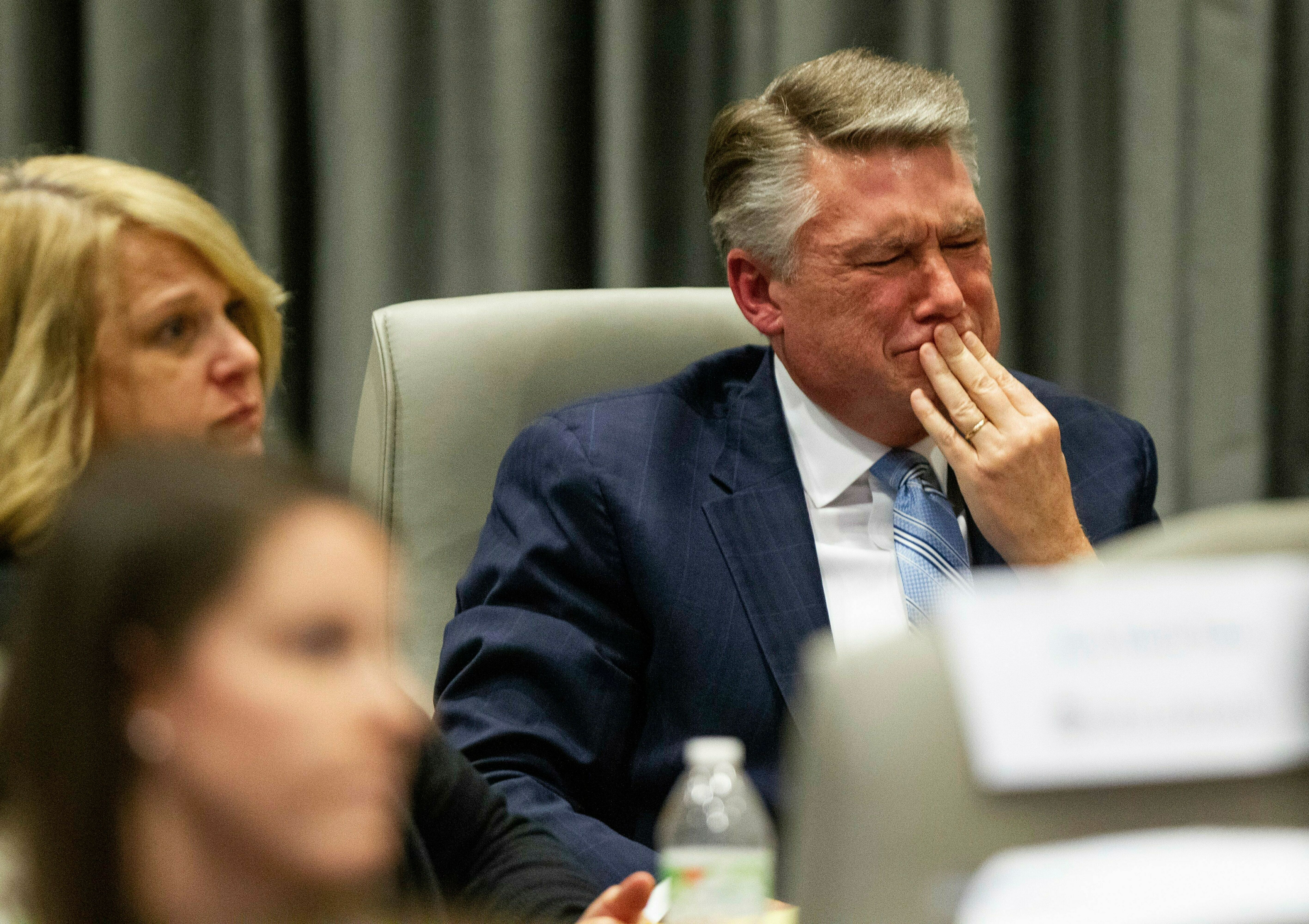 GOP candidate Mark Harris cries as his son testifies at a hearing about allegations of absentee ballot fraud on Wednesday.