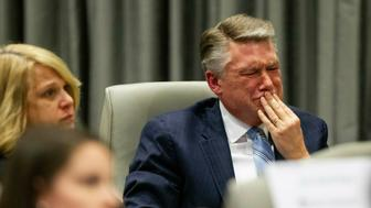 Mark Harris, Republican candidate in North Carolina's 9th Congressional race, fights back tears at the conclusion of his son John Harris's testimony during the third day of a public evidentiary hearing on the 9th Congressional District voting irregularities investigation Wednesday, Feb. 20, 2019, at the North Carolina State Bar in Raleigh. (Travis Long/The News & Observer via AP, Pool)