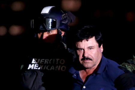 """FILE PHOTO: Joaquin """"El Chapo"""" Guzman is escorted by soldiers during a presentation at the hangar belonging to the office of the Attorney General in Mexico City, Mexico January 8, 2016.  REUTERS/Edgard Garrido/File Photo"""