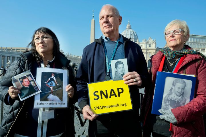 Survivors Network of those Abused by Priests (SNAP) President Tim Lennon from Tucson, Ariz., center, and SNAP members Esther