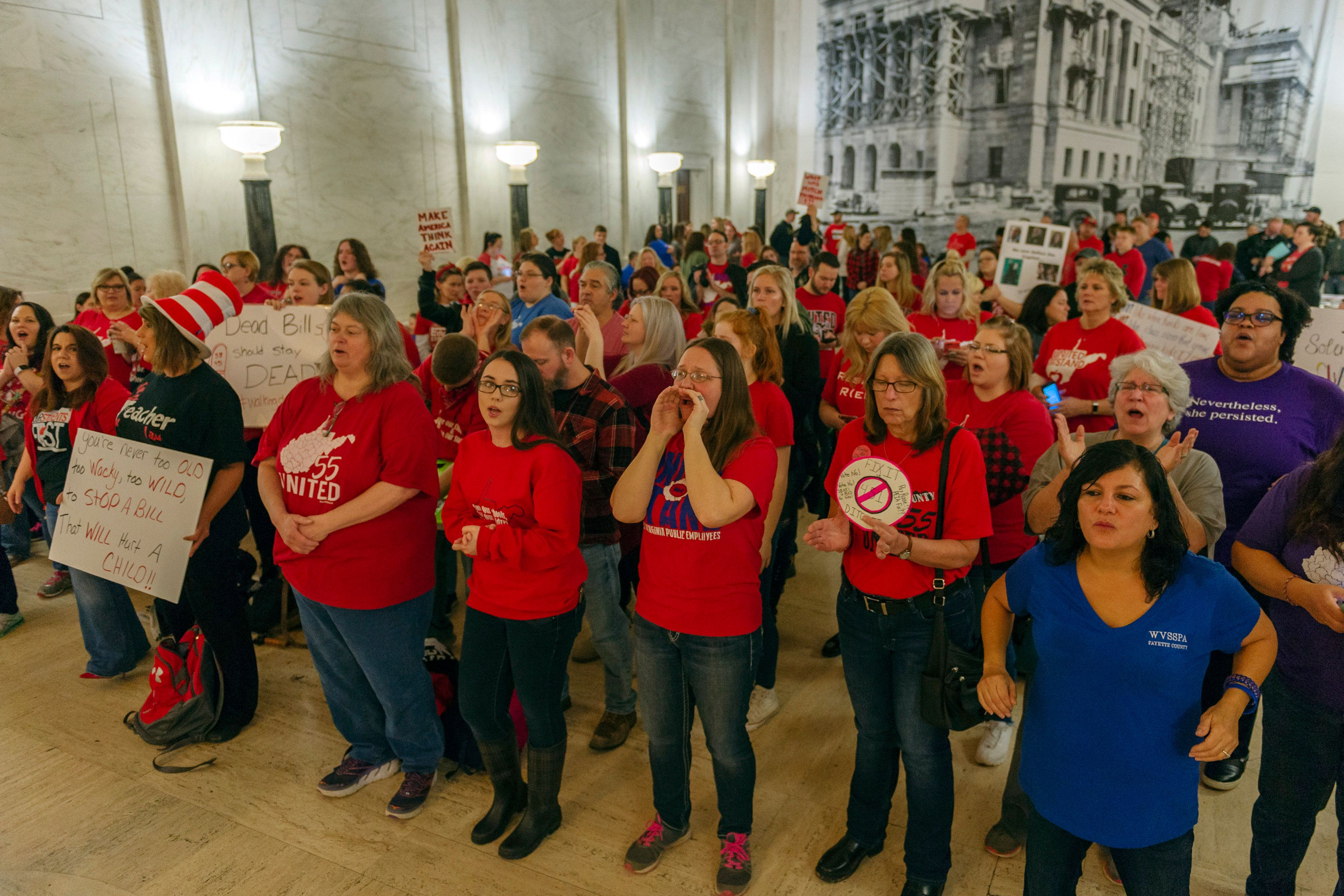 CORRECTS DAY OF WEEK TO WEDNESDAY - Teachers and school personnel, on the second day of a statewide strike, demonstrate outside the House of Delegates chamber, Wednesday, Feb. 20, 2019, at the West Virginia State Capitol in Charleston, W.Va. West Virginia public school teachers are striking for a second day even though legislation they loathed was tabled in the House of Delegates. Schools in 54 of the state's 55 counties were closed Wednesday. The lone holdout again was Putnam County. (Craig Hudson/Charleston Gazette-Mail via AP)