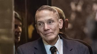 Physicist William Happer stands inside the elevator in the lobby of Trump Tower in New York, U.S., on Friday, Jan. 13, 2017. President-elect Donald Trump said his administration would produce a full report on hacking within the first 90 days of his presidency and accused 'my political opponents and a failed spy' of making 'phony allegations' against him. Photographer: Albin Lohr-Jones/Pool via Bloomberg