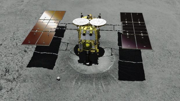This computer graphic image provided by the Japan Aerospace Exploration Agency (JAXA) shows the Japanese unmanned spacecraft Hayabusa2 approaching on the asteroid Ryugu. Japan's space agency is delaying a spacecraft touchdown on an asteroid as scientists need more time to find a safe landing site on the extremely rocky surface. (JAXA via AP)