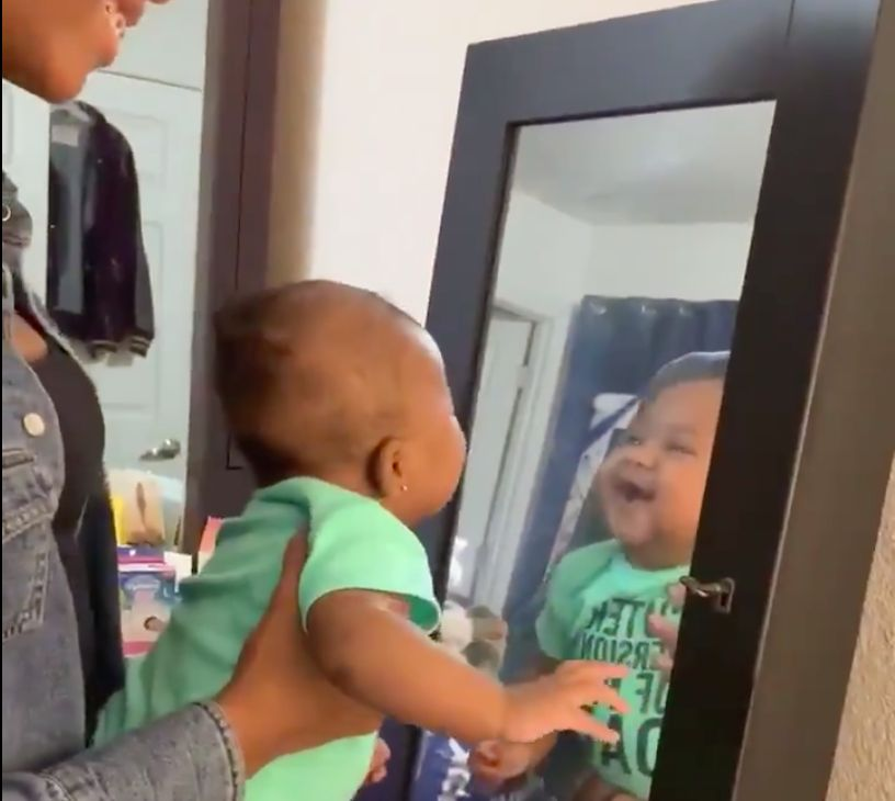 PURE JOY: We Should All Love Our Reflection As Much As This Baby