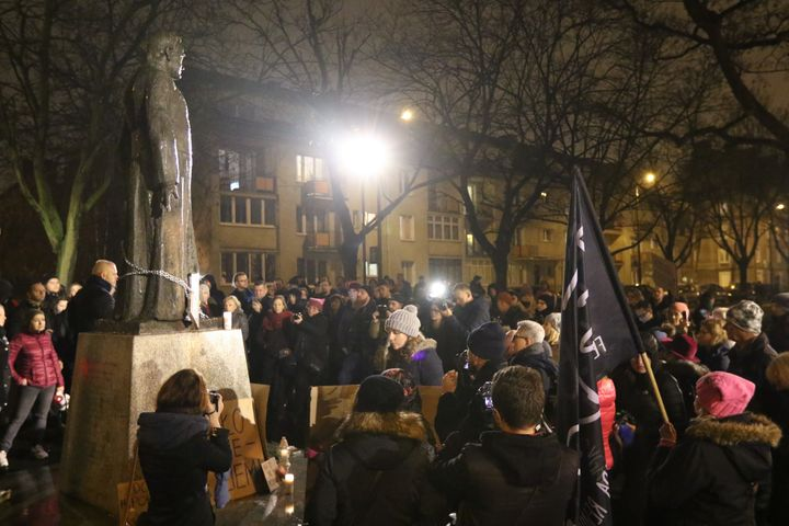 People protest at a monument and square named after priest Henryk Jankowski in Gdansk, Poland, on 7 December 2018. Numerous w