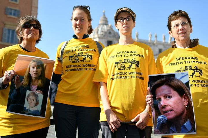 Members of Ending Clergy Abuse, a global organization of survivors and activists, display photos of Barbara Blaine, the late