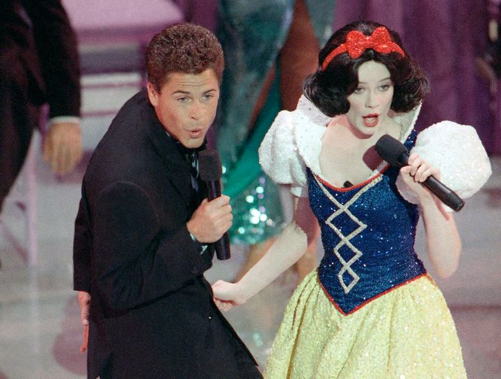 Rob Lowe and Snow White, somehow not a hallucination but rather a shot from the 1989 Oscars.