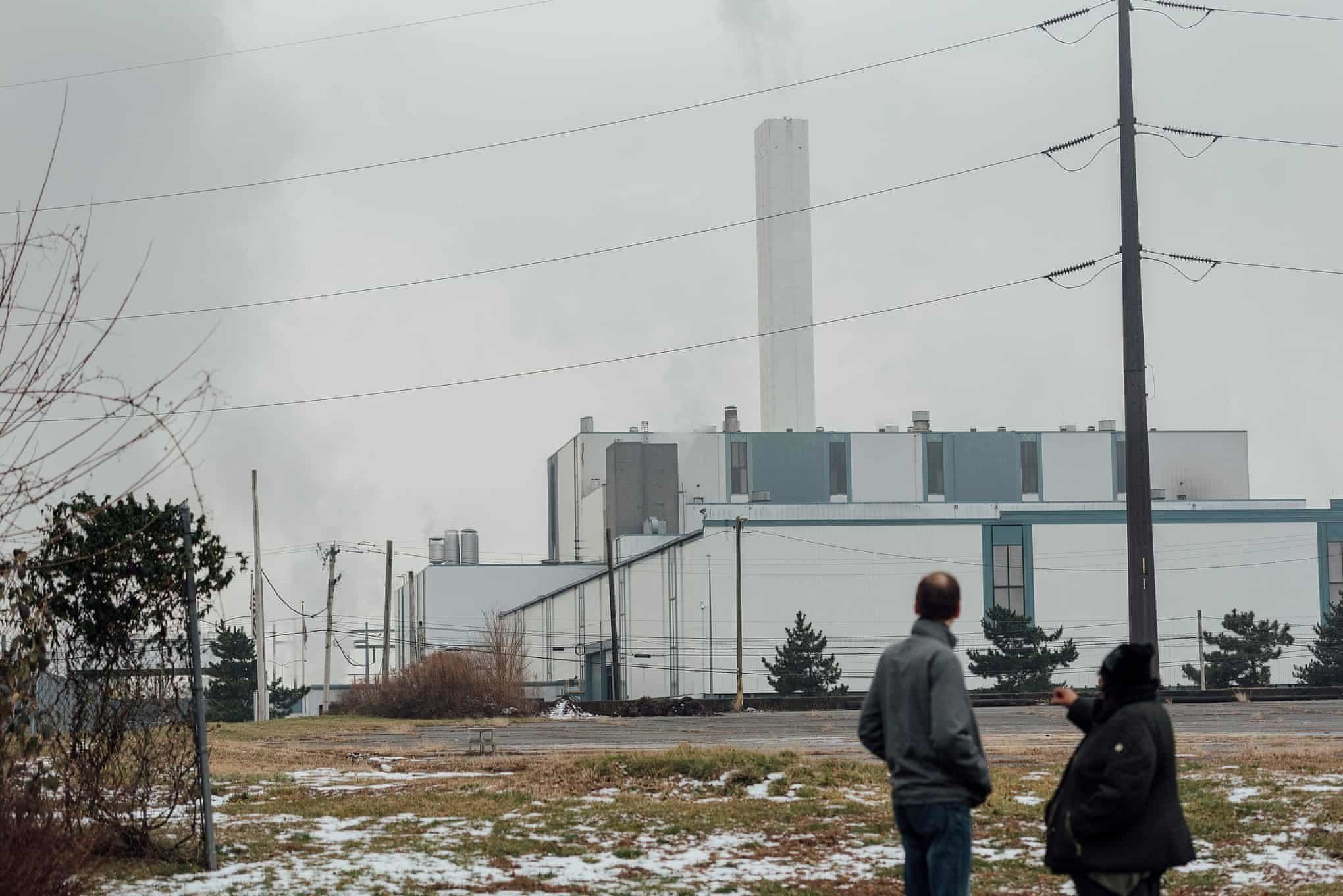 Activists Mike Ewall, left, and Zulene Mayfield stand in front of the Covanta incinerator in Chester, Pennsylvania. The incin