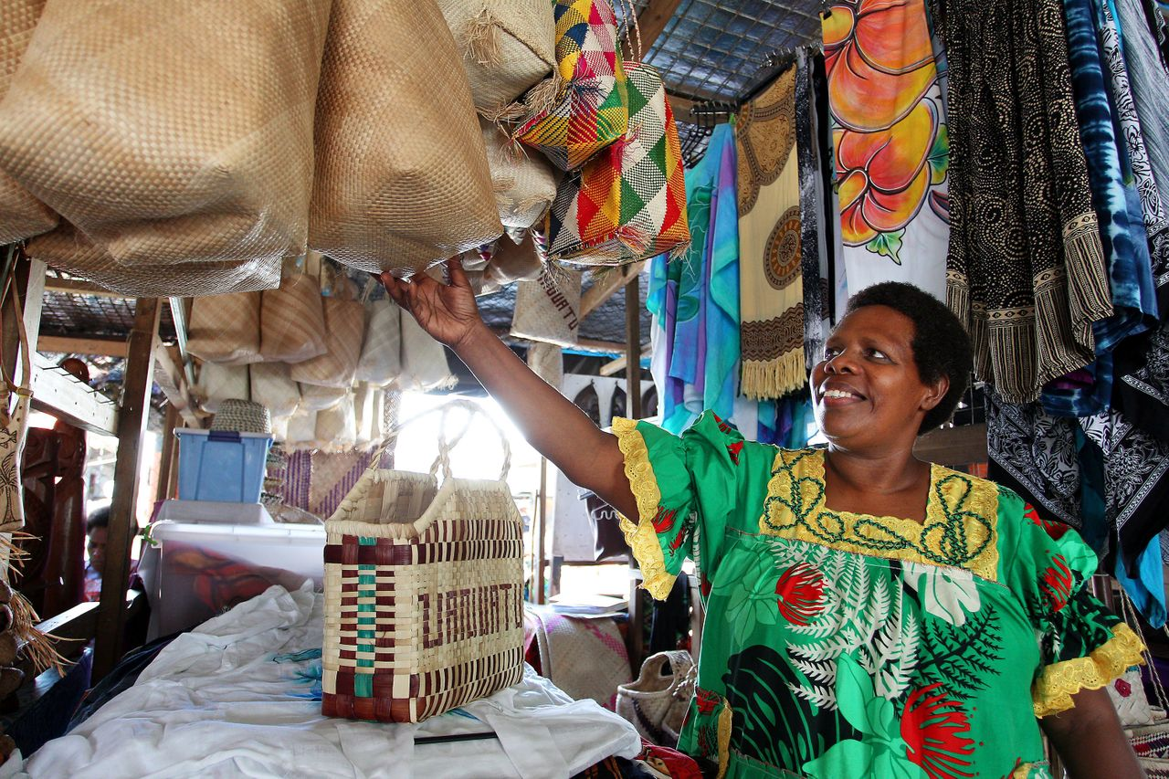 Rebecca Bula, a member and former vice president of a local handicraft cooperative, stands at her stall at the Port Vila markets in February 2019.