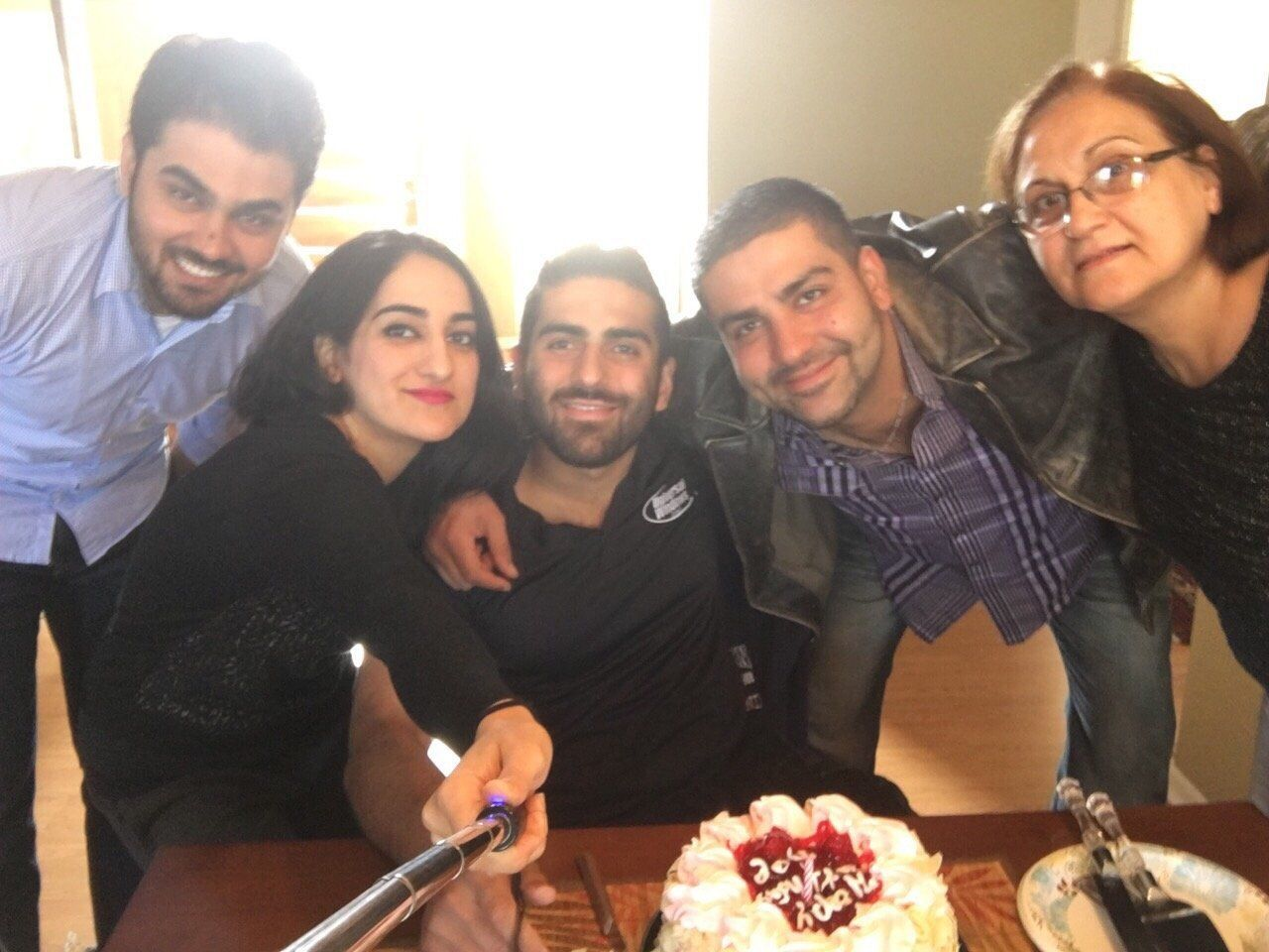 Mustafa Ayoubi (second from the right) and family pose for a photo. His sister Zahra is holding the selfie stick.