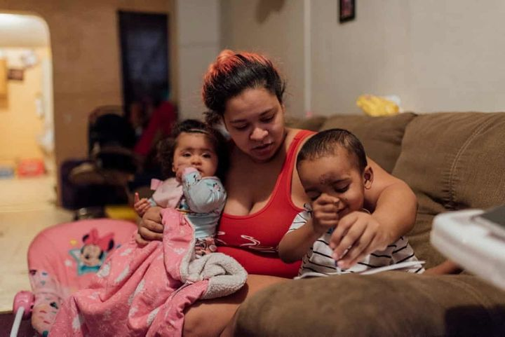 Ashley Melecio, center, sits with her daughter Da'miaa Morales, left, and her son Da'ahmeer Melecio-Martinez at h