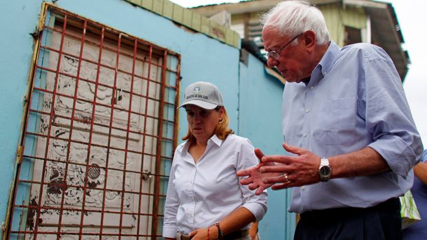 US Sen. Bernie Sanders (I- VT) talks to the Mayor of San Juan, Carmen Yulin Cruz during a visit to the Playita community in San Juan, Puerto Rico, on October 27, 2017. More than 73,000 people have fled emergency conditions at home for Florida since Hurricane Maria devastated the US territory in the Caribbean. / AFP PHOTO / Ricardo ARDUENGO        (Photo credit should read RICARDO ARDUENGO/AFP/Getty Images)