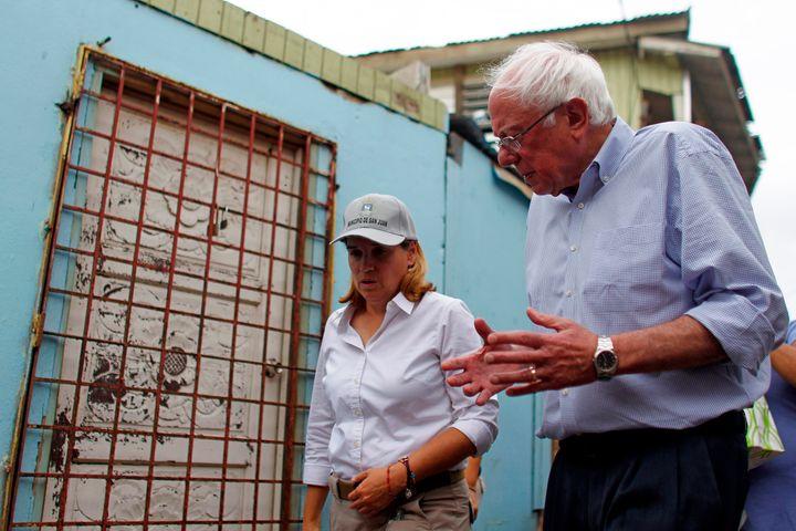 Sen. Bernie Sanders (I- Vt.) talks to the Mayor of San Juan, Carmen Yulin Cruz during a visit to the Playita community in San