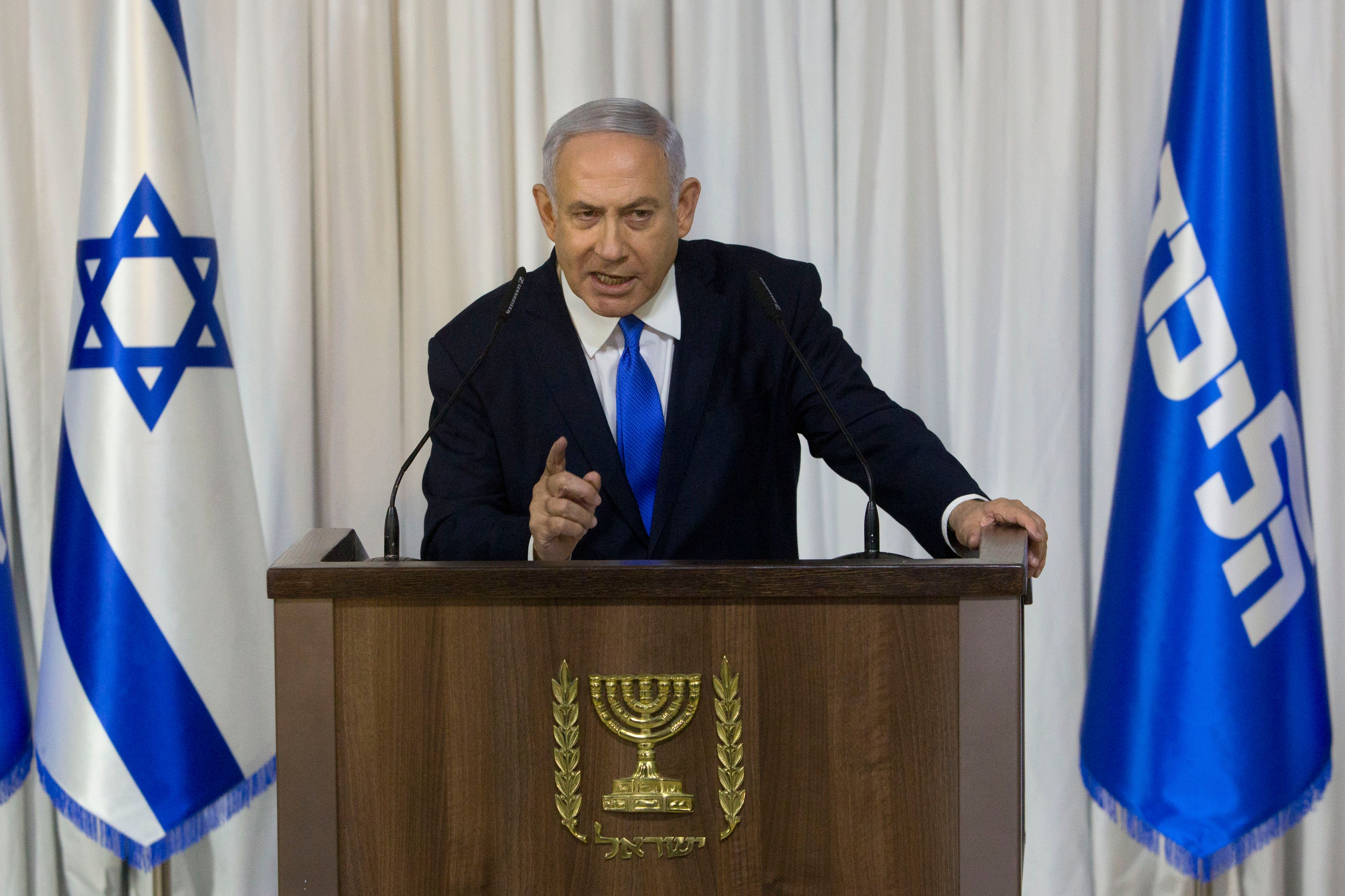 Israeli Prime Minister Benjamin Netanyahu gestures as he delivers a statement in Ramat Gan, Israel, Thursday, Feb. 21, 2019. (AP Photo/Sebastian Scheiner)
