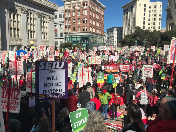 Oakland teachers strike outside Oakland city hall at Frank Ogawa Plaza -- Feb. 21, Oakland, California.
