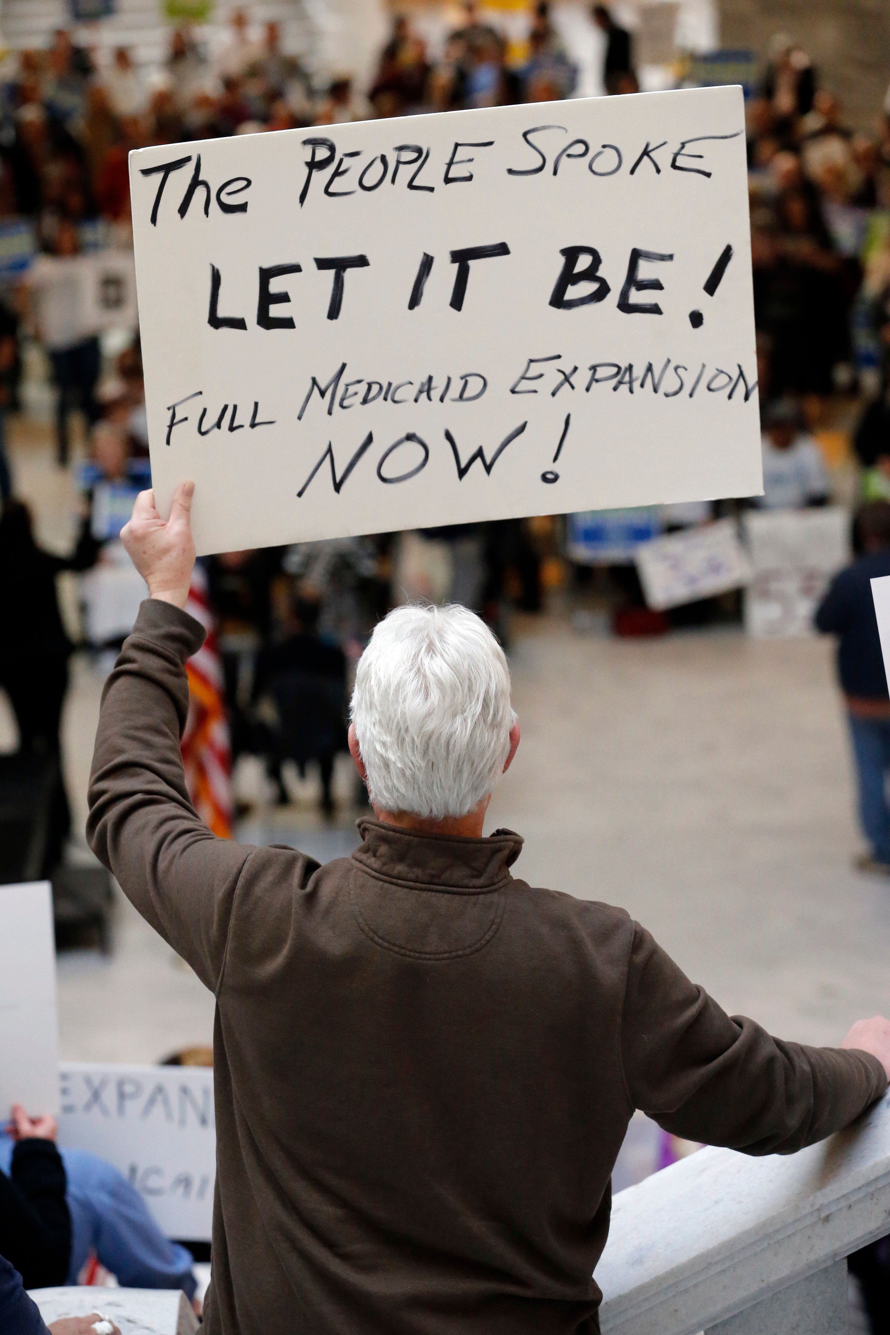 Supporters of a voter-approved measure to fully expand Medicaid gather at a rally to ask lawmakers not to change the law at t