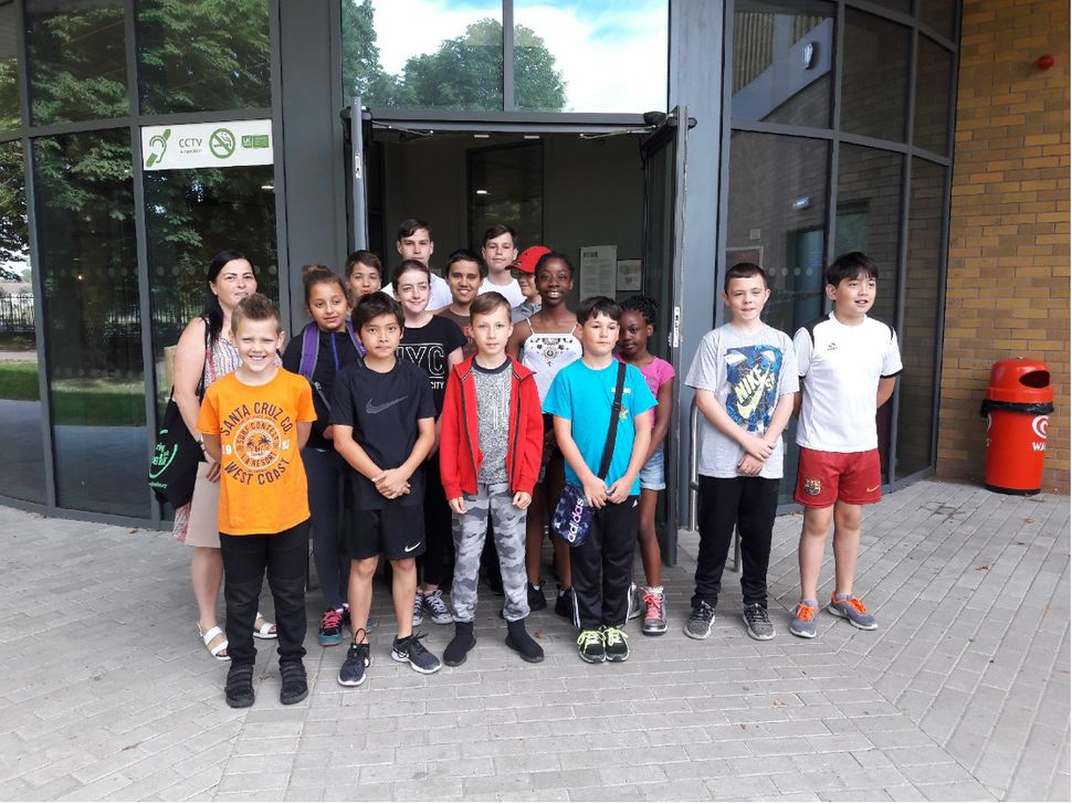 Toprak with a group of young people at the climbing walls at Eltham,
