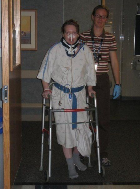 Piazza learning to walk again with the help of a physical therapist.