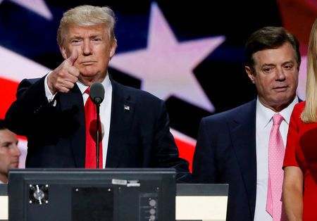 FILE PHOTO: Then Republican presidential nominee Donald Trump gives a thumbs up as his campaign manager Paul Manafort looks on during Trump's walk through at the Republican National Convention in Cleveland, U.S., July 21, 2016. REUTERS/Rick Wilking/File Photo