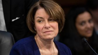 """Senate Judiciary Committee member Sen. Amy Klobuchar, D-Minn., prepares to vote against advancing William Barr's nomination for attorney general, as the panel meets on Capitol Hill in Washington, Thursday, Feb. 7, 2019. """"This is not the time to install an attorney general who has repeatedly espoused a view of unfettered executive power."""" Klobuchar said Thursday. (AP Photo/J. Scott Applewhite)"""