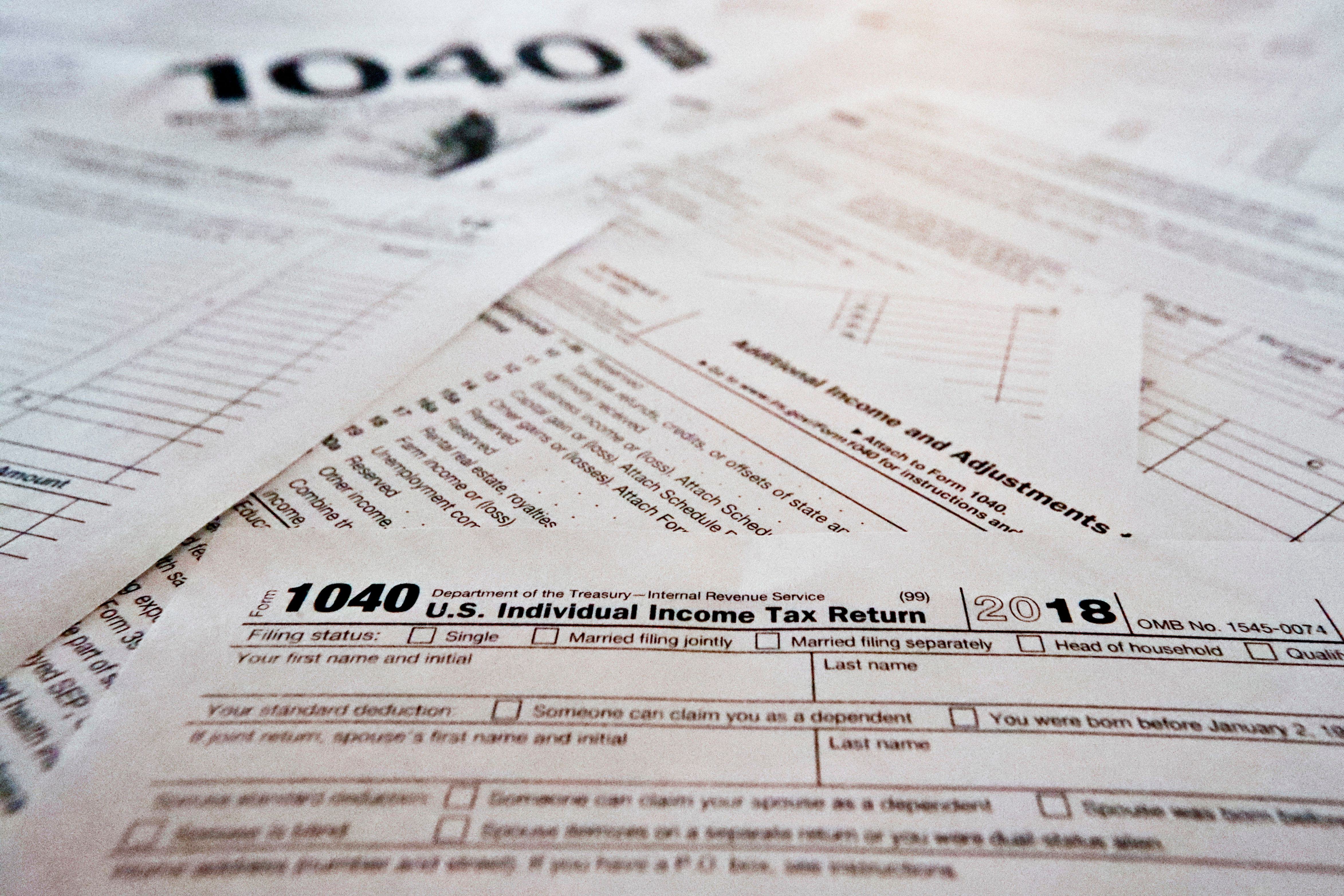 This Wednesday, Feb. 13, 2019, in Zelienople, Pa., shows multiple forms printed from the Internal Revenue Service web page that are used for 2018 U.S. federal tax returns. The government says that the average tax refund and the total amount of refunds issued have declined for the second straight week. The declines have become a political issue, as Democrats contend they show how the new Republican-written tax law hurts middle-class people. (AP Photo/Keith Srakocic)