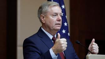 "Republican Sen. Lindsey Graham gestures as he speaks to reporters in Ankara, Turkey, Saturday, Jan. 19, 2019, a day after meeting with Turkish President Recep Tayyip Erdogan and other officials. Graham says a U.S. withdrawal from Syria without a plan would lead to chaos and an ""Iraq on steroids."" (AP Photo/Burhan Ozbilici)"