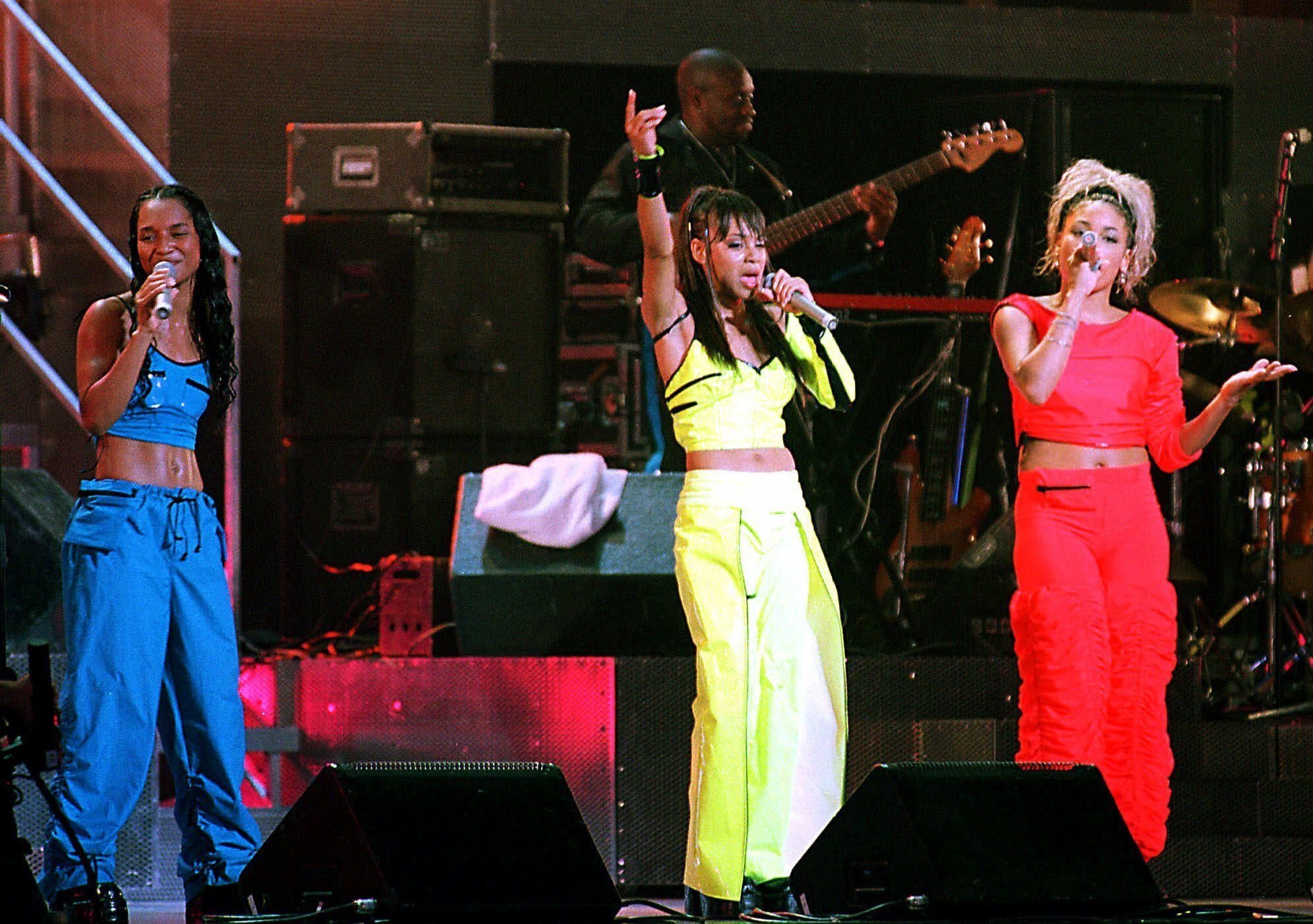 """TLC performs during a charity concert along with American artist Monica and Japanese teenage star Utada Hikaru at Tokyo's Nippon Budokan hall Tuesday night, Aug. 24, 1999.  With nine numbers from the group's latest hit album """"Fanmail,""""  the TLC joined with others for the concert to raise funds for the World Wide Fund for Nature (WWF). (AP Photo/Koji Sasahara)"""