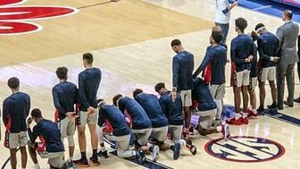 Ole Miss players kneel. (Oxford Eagle via AP)