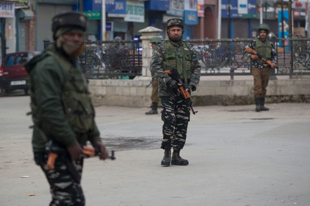 Paramilitary soldiers stand guard in a closed market in Srinagar, Kashmir, Feb. 23,