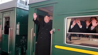 North Korean leader Kim Jong Un waves from a train as he departs for a summit in Hanoi, in Pyongyang, North Korea in this photo released by North Korea's Korean Central News Agency (KCNA) on February 23, 2019. KCNA via REUTERS    ATTENTION EDITORS - THIS IMAGE WAS PROVIDED BY A THIRD PARTY. REUTERS IS UNABLE TO INDEPENDENTLY VERIFY THIS IMAGE. NO THIRD PARTY SALES. SOUTH KOREA OUT. NO COMMERCIAL OR EDITORIAL SALES IN SOUTH KOREA.