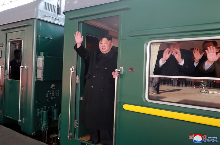North Korean leader Kim Jong Un waves from a train as he departs Pyongyang for a summit in Hanoi, Vietnam.
