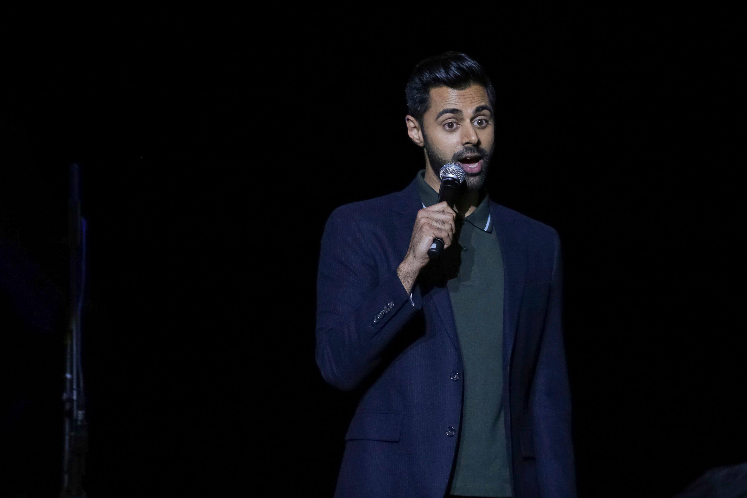 Comedian Hasan Minhaj performs on stage during the 11th Annual Stand Up for Heroes benefit, presented by the New York Comedy Festival and The Bob Woodruff Foundation, at the Theater at Madison Square Garden on Tuesday, Nov. 7, 2017, in New York. (Photo by Brent N. Clarke/Invision/AP)