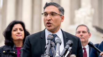 Neal Katyal, the attorney who argued against the Trump administration in the case Trump v. Hawaii, speaks to members of the media outside the Supreme Court, Wednesday, April 25, 2018, in Washington.  President Donald Trump appears likely to win his travel ban case at the Supreme Court. Chief Justice John Roberts and Justice Anthony Kennedy both signaled support for the travel policy in arguments at the high court. The ban's challengers almost certainly need one of those two justices if the court is to strike down the ban on travelers from several mostly Muslim countries. (AP Photo/Andrew Harnik)