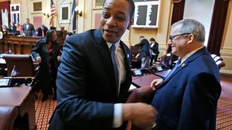 "Virginia Lt. Gov Justin Fairfax shakes the hand of State Sen. Adam Ebbin, D-Alexandria, right, as he exits the floor after the Senate adjourned their 2019 session at the Capitol in Richmond, Va., Sunday, Feb. 24, 2019. Fairfax delivered an impassioned speech and said ""If we go backwards and we rush to judgment and we allow for political lynchings without any due process, any facts, any evidence being heard, then I think we do a disservice to this very body in which we all serve."" (AP Photo/Steve Helber)"