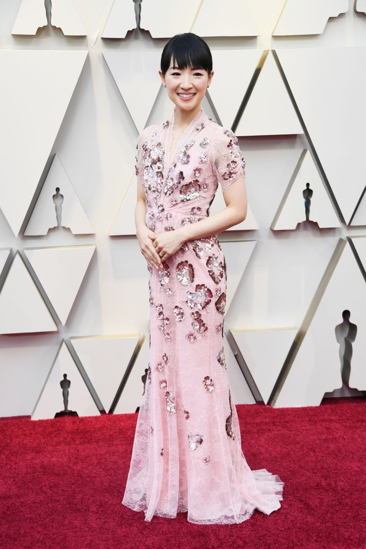 Kondo wore a pink gown with sequined flowers and lace embellishments by Jenny Packham.
