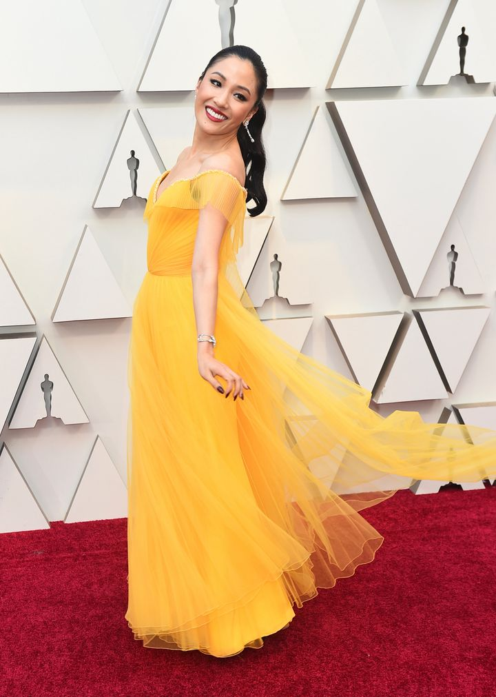 Constance Wu in a custom, bold yellow Versace gown.