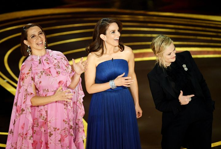 Maya Rudolph, Tina Fey, and Amy Poehler speak onstage during the 91st Annual Academy Awards.