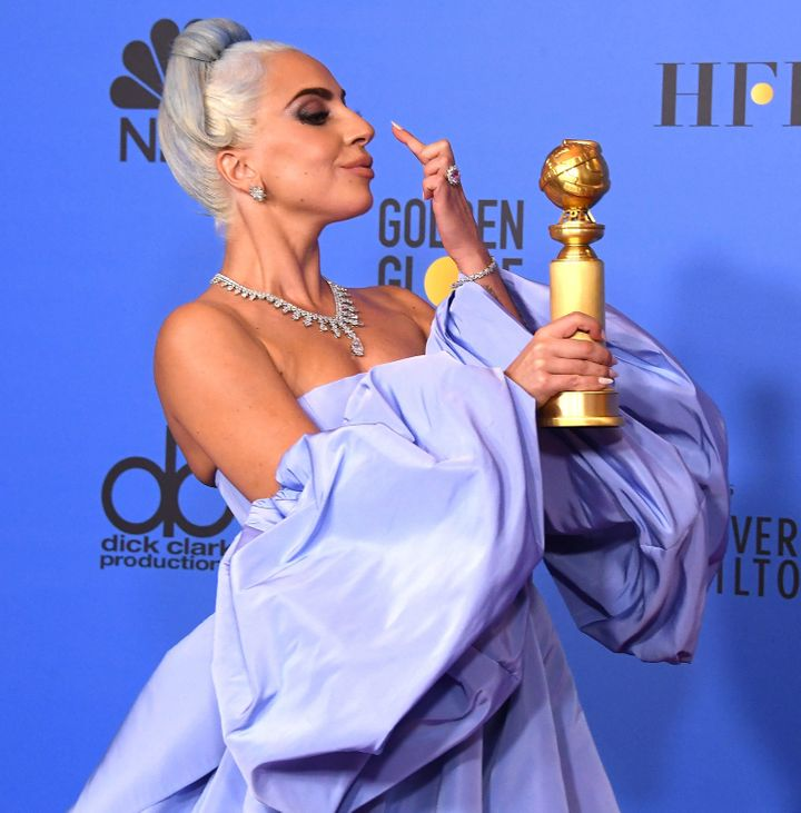 Lady Gaga celebrates her Golden Globes win after the ceremony.
