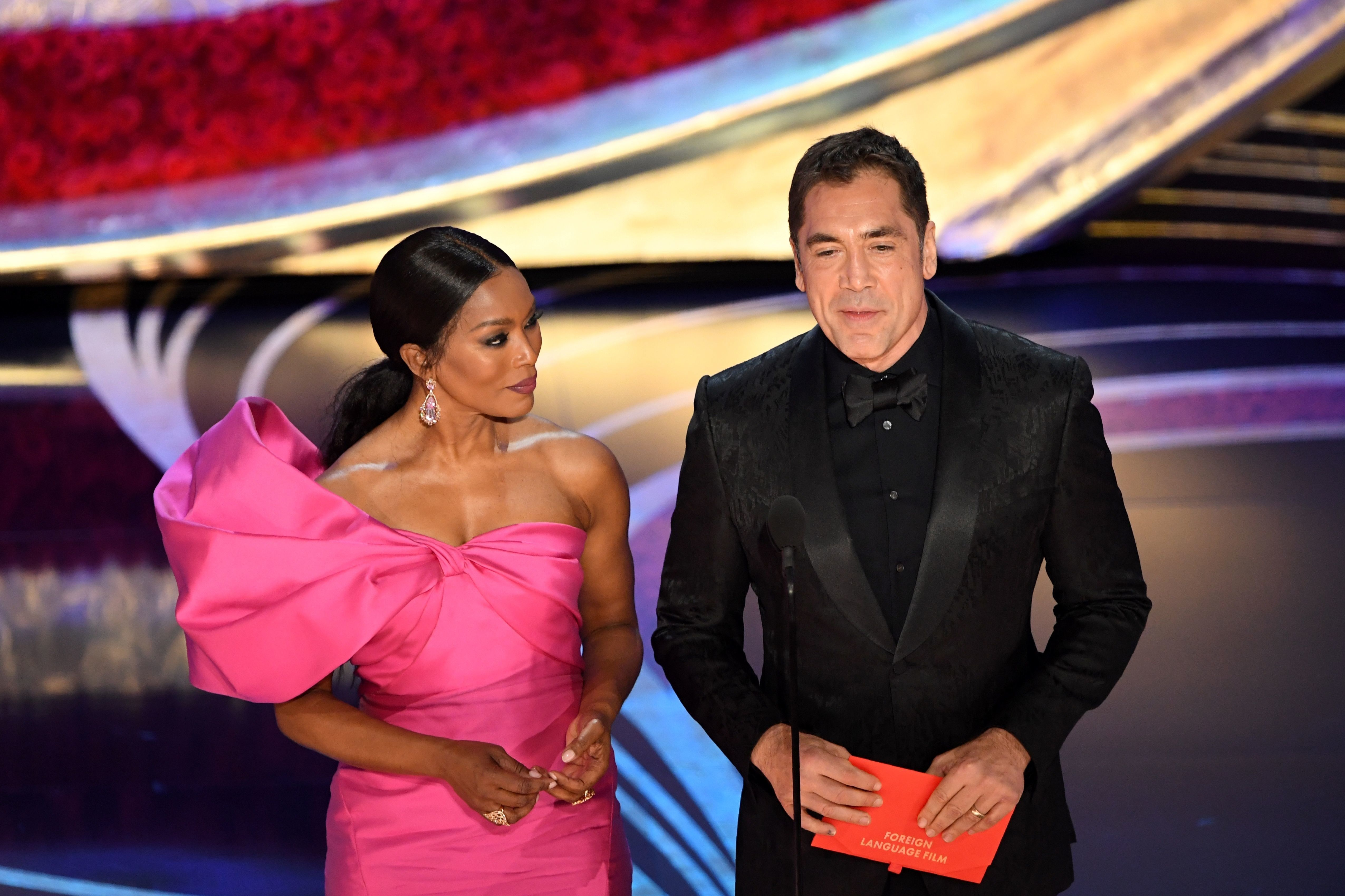 US actress Angela Bassett and Spanish Actor Javier Bardem present an award during the 91st Annual Academy Awards at the Dolby Theatre in Hollywood, California on February 24, 2019. (Photo by VALERIE MACON / AFP)        (Photo credit should read VALERIE MACON/AFP/Getty Images)