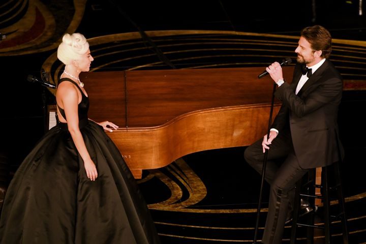 Gaga and Bradley on stage during the Oscars