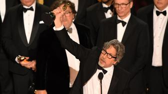The producer of Best Picture nominee 'Green Book' Peter Farrelly accepts the award for Best Picture with the whole crew on stage during the 91st Annual Academy Awards at the Dolby Theatre in Hollywood, California on February 24, 2019. (Photo by VALERIE MACON / AFP)        (Photo credit should read VALERIE MACON/AFP/Getty Images)