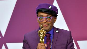 "Spike Lee poses with the award for best adapted screenplay for ""BlacKkKlansman"" in the press room at the Oscars on Sunday, Feb. 24, 2019, at the Dolby Theatre in Los Angeles. (Photo by Jordan Strauss/Invision/AP)"