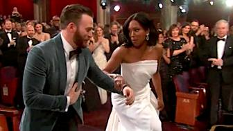 Chris Evans helped Oscar winner Regina King onto the stage after she almost tripped.