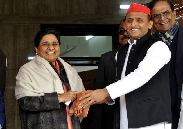 Samajwadi Party president Akhilesh Yadav with Bahujan Samaj Party chief Mayawati in Lucknow, on 15 January
