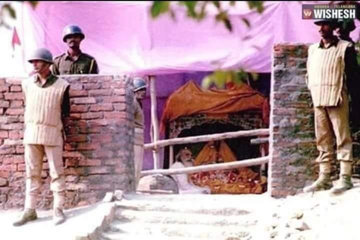 Acharya Satyendra Das offers prayers at the makeshift Ram Mandir after the Babri Masjid was demolished...