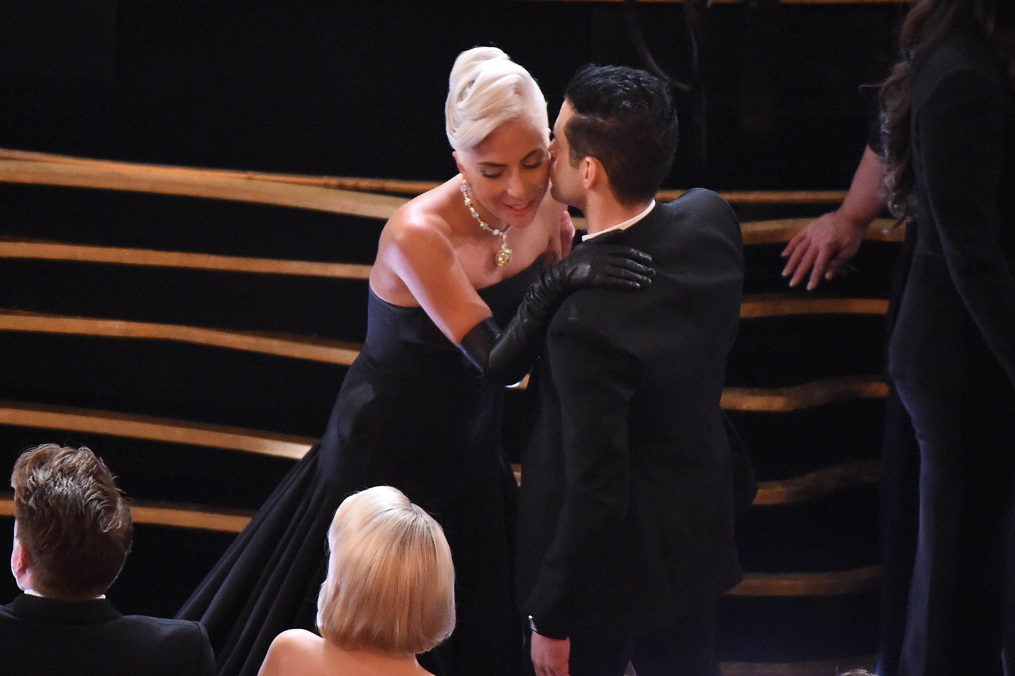 Singer and actress Lady Gaga and US actor Rami Malek chat during the 91st Annual Academy Awards at the Dolby Theatre in Hollywood, California on February 24, 2019. (Photo by VALERIE MACON / AFP)        (Photo credit should read VALERIE MACON/AFP/Getty Images)