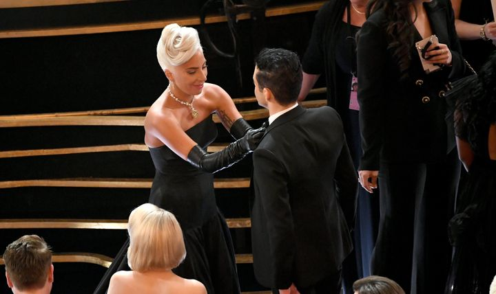 Gaga fixes Malek's tie during Sunday night's Oscars ceremony.