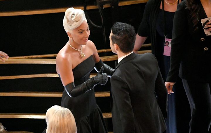 Gaga gave him an adorable thumbs up after fixing the actor's bow tie.