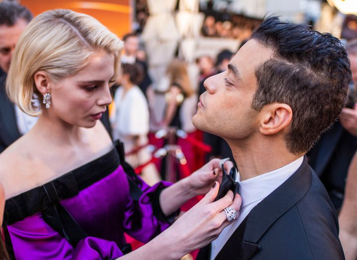 Lucy Boynton and Rami Malek arrive at the Oscars on Sunday, Feb. 24, 2019, at the Dolby Theatre in Los Angeles.